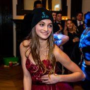 Girl wearing beanie at bat mitzvah dance