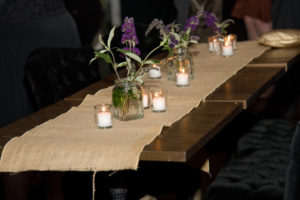 Vintage bottles on burlap runner for bohemian tablescape
