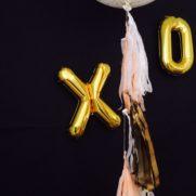 Birthday party with xo gold mylar balloons fringe tassel