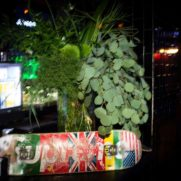 slate skateboard with tablescape greens at bar mitzvah