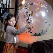 confetti balloon decor at 26 bridge party